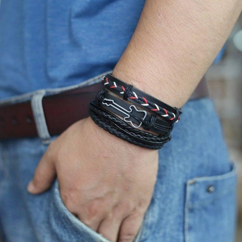 4-Piece Black Bracelet Set with Decorative Charm